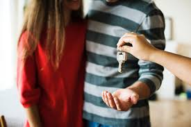 House keys being handed to a couple