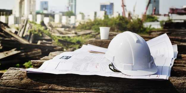construction hardhat and plans